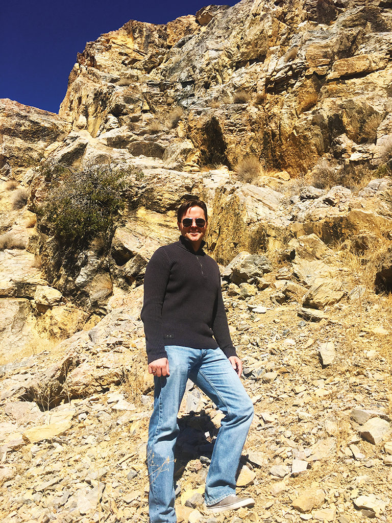 Jerald Simon standing near the cliff where he (Jerald Simon) fell off in 1988 (Music Motivation - musicmotivation.com)